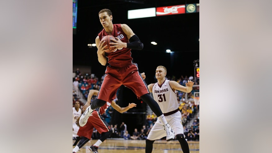 Stanford's Dwight Powell grabs a rebound against Arizona State in the first half of an NCAA college basketball game in the Pac-12 men's tournament quarterfinals, Thursday, March 13, 2014, in Las Vegas. (AP Photo/Julie Jacobson)