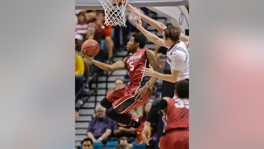 Stanford's Chasson Randle puts up a reverse layup against Arizona State in the first half of an NCAA college basketball game in the Pac-12 men's tournament quarterfinals, Thursday, March 13, 2014, in Las Vegas. (AP Photo/Julie Jacobson)