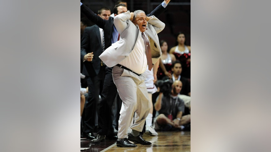 New Mexico State coach Marvin Menzies reacts to a call during the second half of an NCAA college basketball game against Seattle in the first round of the West Athletic Conference men's tournament Thursday, March 13, 2014, in Las Vegas. New Mexico State won 70-68. (AP Photo/David Becker)