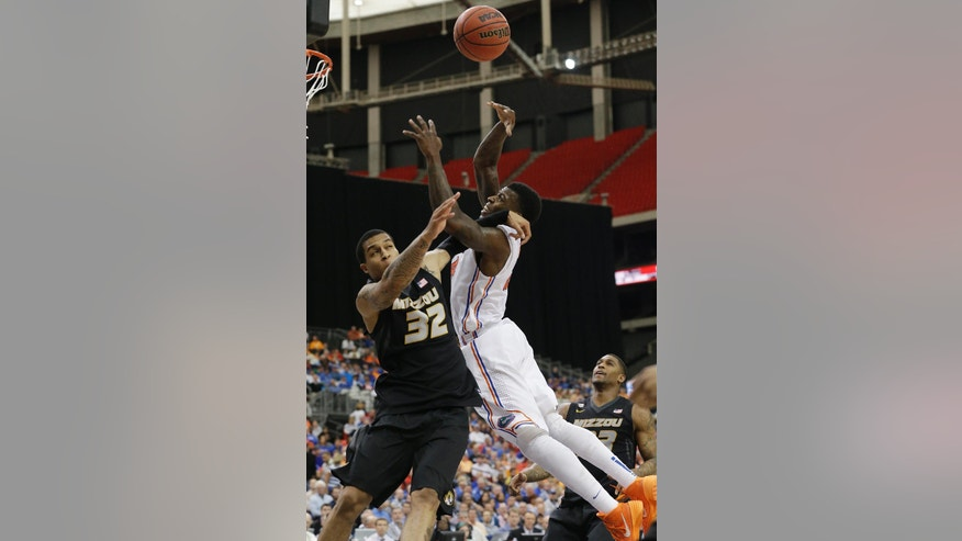 Florida forward Casey Prather (24) shoots over Missouri guard Jabari Brown (32) during the second half of an NCAA college basketball game in the quarterfinal round of the Southeastern Conference men's tournament, Friday, March 14, 2014, in Atlanta. (AP Photo/Steve Helber)
