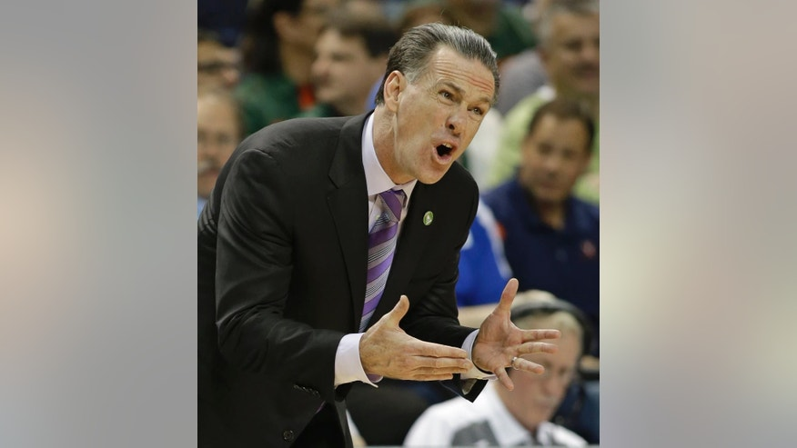 Pittsburgh head coach Jamie Dixon talks to his team during the first half  of an NCAA college basketball game against North Carolina in the quarterfinal round of the Atlantic Coast Conference tournament in Greensboro, N.C., Friday, March 14, 2014. (AP Photo/Bob Leverone)