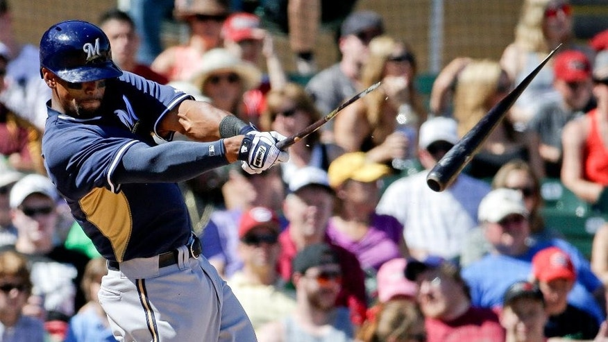 Milwaukee Brewers' Khris Davis breaks his bat during the third inning of a spring exhibition baseball game against the Arizona Diamondbacks in Scottsdale, Ariz., Sunday, March 16, 2014. (AP Photo/Chris Carlson)