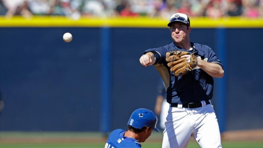 Kansas City Royals' Danny Valencia is forced out at second as San Diego Padres' Jedd Gyorko throws to first during the second inning of a spring exhibition baseball game Sunday, March 16, 2014, in Peoria, Ariz. (AP Photo/Darron Cummings)