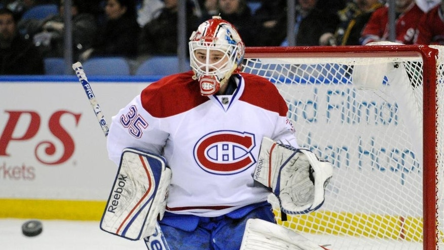 Montreal Canadiens goaltender Dustin Tokarski makes a save during the first period of an NHL hockey game against the Buffalo Sabres in Buffalo, N.Y., Sunday, March 16, 2014. (AP Photo/Gary Wiepert)
