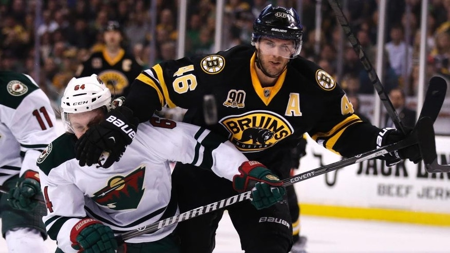 Boston Bruins right wing Jarome Iginla (12) smiles as he is congratulated by teammates after his goal during the second period of an NHL hockey game, Monday, March 17, 2014, in Boston. (AP Photo/Charles Krupa)