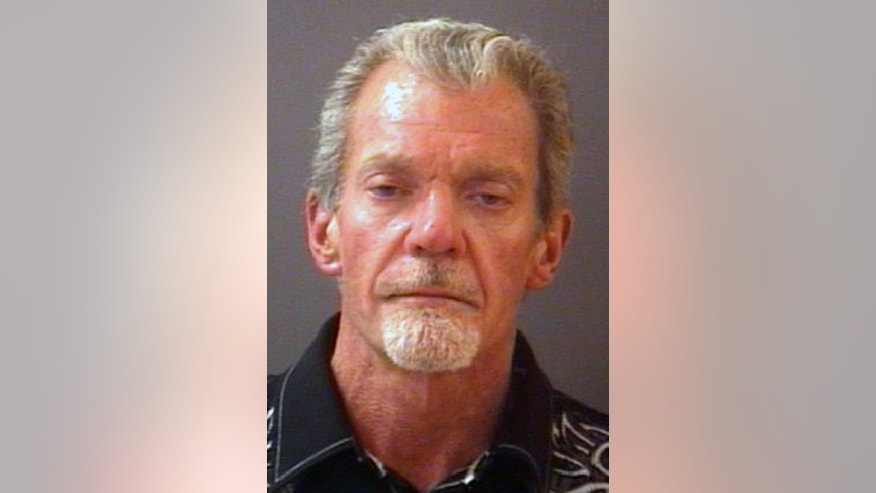 This mug shot provided by the Hamilton County Sheriff's Department shows Indianapolis Colts owner Jim Irsay. Authorities say Irsay is in jail after being stopped on suspicion of drunken driving. Hamilton County Sheriff's Department Deputy Bryant Orem says Irsay was arrested Sunday night, March 16, 2014, in the northern Indianapolis suburb of Carmel. (AP/Hamilton County Sherriff's Department)