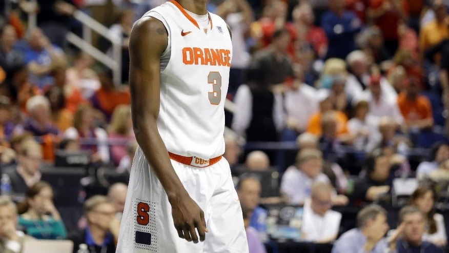 Syracuse's Jerami Grant (3) walks off the court after their loss to North Carolina State in a quarterfinal NCAA college basketball game at the Atlantic Coast Conference tournament in Greensboro, N.C., Friday, March 14, 2014. North Carolina State won 66-63. (AP Photo/Gerry Broome)