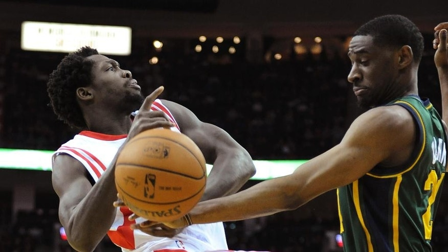 Utah Jazz's Ian Clark, right, knocks the ball away from Houston Rockets's Patrick Beverley in the first half of an NBA basketball game Monday, March 17, 2014, in Houston. (AP Photo/Pat Sullivan)