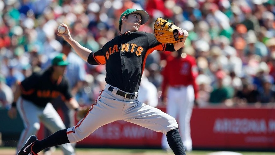 San Francisco Giants' Tim Lincecum throws a pitch against the Los Angeles Angels in the first inning of a spring training baseball game, Monday, March 17, 2014, in Tempe, Ariz. (AP Photo/Ross D. Franklin)