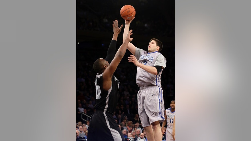 Creighton's Doug McDermott (3) shoots over Providence's Kadeem Batts (10) during the firsthalf of an NCAA college basketball game in the finals of the Big East Conference tournament Saturday, March 15, 2014, at Madison Square Garden in New York. (AP Photo/Frank Franklin II)