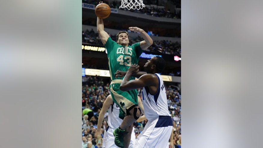 Boston Celtics center Kris Humphries (43) drives against Dallas Mavericks center Samuel Dalembert (1) during the first half an NBA basketball game Monday, March 17, 2014, in Dallas. (AP Photo/LM Otero)