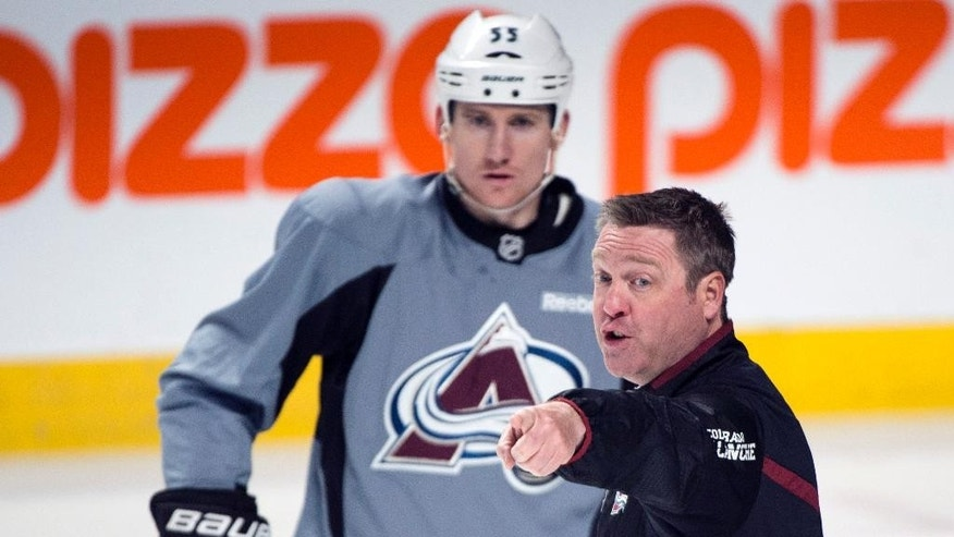 Colorado Avalanche head coach Patrick Roy talks with Cody McLeod, left, during an NHL hockey practice, Monday, March 17, 2014, in Montreal. (AP Photo/The Canadian Press, Paul Chiasson)