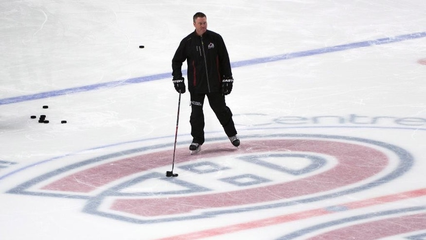 Colorado Avalanche head coach Patrick Roy skates at center ice during an NHL hockey practice Monday, March 17, 2014, in Montreal. (AP Photo/The Canadian Press, Paul Chiasson)