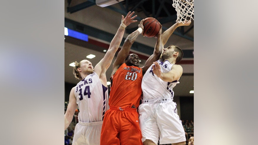 Sam Houston State's James Thomas (20) is fouled by Stephen F. Austin's Nikola Gajic (4) as  Jacob Parker (34) assists on the defense during the first half of an NCAA college basketball game in the championship of the Southland Conference tournament Saturday, March 15, 2014, in Katy, Texas. (AP Photo/Bob Levey)
