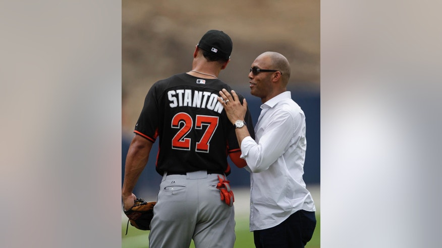 Former New York Yankees pitcher Mariano Rivera, right, talks with Miami Marlins Giancarlo Stanton prior to a Legend Series exhibition baseball game between the Yankees and the Marlins played in Rivera's honor in Panama City, Sunday, March 16, 2014. (AP Photo/Arnulfo Franco)