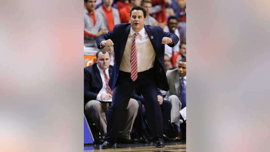 Arizona coach Sean Miller motions to a referee in the second half against UCLA during the championship game of the NCAA Pac-12 conference college basketball tournament, Saturday, March 15, 2014, in Las Vegas. UCLA won 75-71. (AP Photo/Julie Jacobson)
