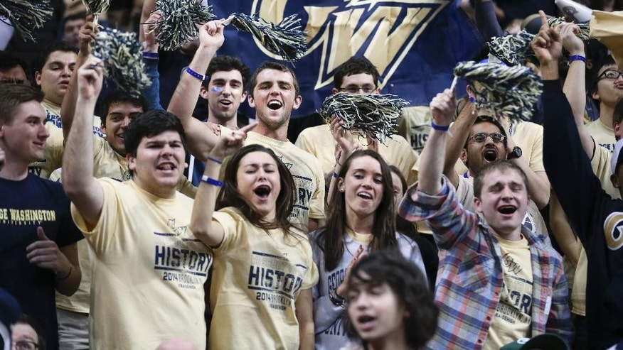 George Washington fans cheer during the second half of the team's NCAA college basketball game against Massachusetts in the quarterfinal round of the Atlantic 10 Conference men's tournament in New York, Friday, March 14, 2014. George Washington defeated UMass 85-77. (AP Photo/John Minchillo)