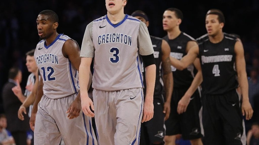 Creighton's Doug McDermott (3) and Jahenns Manigat (12) react during the second half of an NCAA college basketball game against Providence in the finals of the Big East Conference tournament Saturday, March 15, 2014, at Madison Square Garden in New York. Providence won the game 65-58. (AP Photo/Frank Franklin II)