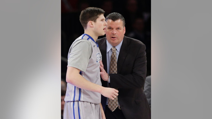 Creighton head coach Greg McDermott talks to Doug McDermott, left, during the first half of an NCAA college basketball game against Providence in the finals of the Big East Conference tournament Saturday, March 15, 2014, at Madison Square Garden in New York. (AP Photo/Frank Franklin II)