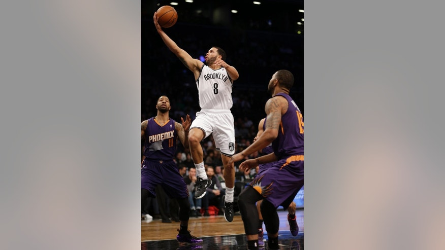 Brooklyn Nets's Deron Williams makes a basket during the first half of the NBA basketball game against the Phoenix Suns at the Barclays Center Monday, March 17, 2014 in New York. (AP Photo/Seth Wenig)