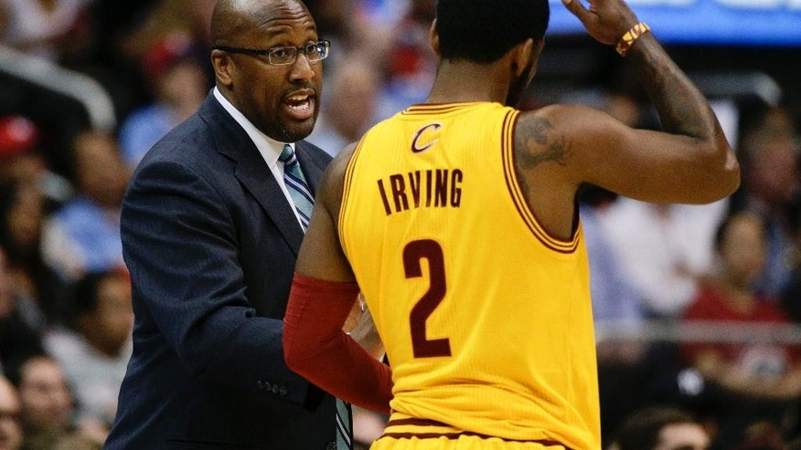 Cleveland Cavaliers's Mike Brown, left, talks to Kyrie Irving during the first half of an NBA basketball game against the Los Angeles Clippers on Sunday, March 16, 2014, in Los Angeles. (AP Photo/Jae C. Hong)
