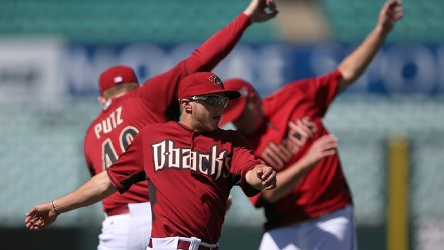The Arizona Diamondbacks' Tony Campana stretches as his team trains at the Sydney Cricket Ground in Sydney, Tuesday, March 18, 2014. The Major League Baseball season-opening two-game series between the Los Angeles Dodgers and Arizona Diamondbacks in Sydney will be played this weekend. (AP Photo/Rick Rycroft)