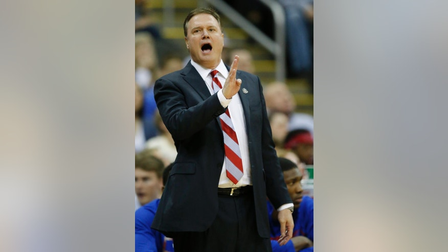 Kansas head coach Bill Self directs his team during the first half of an NCAA college basketball game against Iowa State in the semifinals of the Big 12 Conference men's tournament in Kansas City, Mo., Friday, March 14, 2014. (AP Photo/Orlin Wagner)