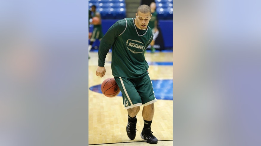 Cal Poly forward Chris Eversley dribbles behind his back during practice for an NCAA college basketball tournament game, Tuesday, March 18, 2014, in Dayton, Ohio. Cal Poly plays Texas Southern Wednesday evening in a first round game. (AP Photo/Al Behrman)