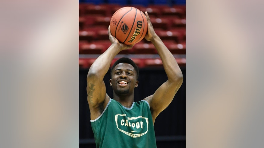 Cal Poly guard Dave Nwaba shoots during practice for an NCAA college basketball tournament game, Tuesday, March 18, 2014, in Dayton, Ohio. Cal Poly plays Texas Southern Wednesday evening in a first round game. (AP Photo/Al Behrman)
