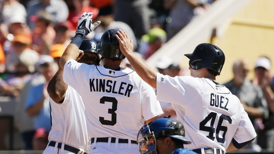 Detroit Tigers' Ian Kinsler is greeted at home plate by teammates Torii Hunter, left, and Ben Guez after scoring on his three-run home run during the fifth inning of a spring exhibition baseball game against the Toronto Blue Jays in Lakeland, Fla., Tuesday, March 18, 2014. (AP Photo/Carlos Osorio)