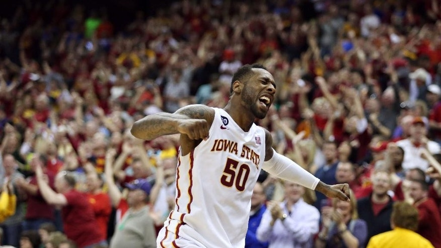 Iowa State's DeAndre Cane celebrates after Iowa State defeated Baylor 74-65 in an NCAA college basketball game for the Big 12 men's tournament title, Saturday, March 15, 2014, in Kansas City, Mo. (AP Photo/The Daily Texan, Shelby Tauber)