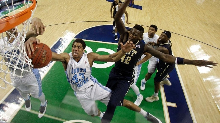 North Carolina's James Michael McAdoo (43) and Pittsburgh's Talib Zanna (42) battle for a rebound during the second half of an NCAA college basketball game in the quarterfinal round of the Atlantic Coast Conference tournament in Greensboro, N.C., Friday, March 14, 2014. Pittsburgh won 80-75. (AP Photo/Bob Leverone)