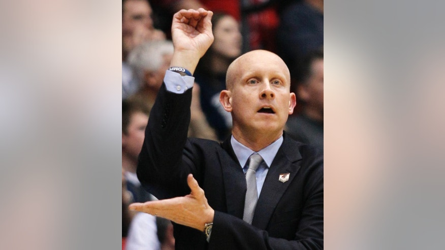 Xavier coach Chris Mack calls a play against North Carolina State during the first half of a first-round game of the NCAA college basketball tournament, Tuesday, March 18, 2014, in Dayton, Ohio. (AP Photo/Skip Peterson)