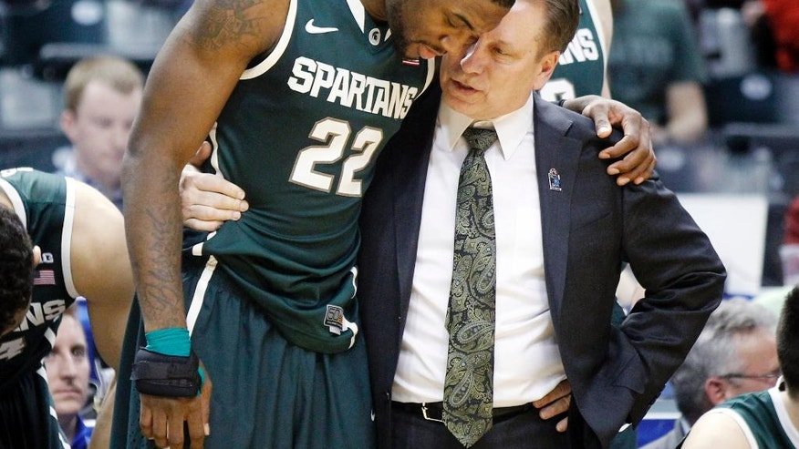 Michigan State head coach Tom Izzo, right, talks to Branden Dawson near the end of the second half of an NCAA college basketball game in the semifinals of the Big Ten Conference tournament Saturday, March 15, 2014, in Indianapolis. Michigan State won 83-75. (AP Photo/Kiichiro Sato)