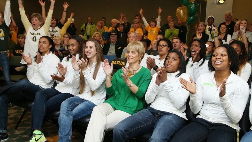 Baylor head coach Kim Mulkey, center watches the NCAA selection show with players  Mariah Chandler,  Nina Davis, Makenzie Robertson, Niya Johnson, and  Odyssey Sims, right during the NCAA selection process, Monday, March 17, 2014, in Waco, Texas. (AP Photo/Waco Tribune Herald, Rod Aydelotte)