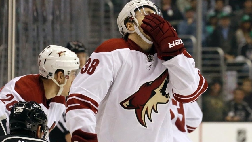 Phoenix Coyotes center Brandon McMillan (38) comes away with a bloody nose after a collision with the Los Angeles Kings in the first period of an NHL hockey game in Los Angeles Monday, March 17, 2014.  (AP Photo/Reed Saxon)