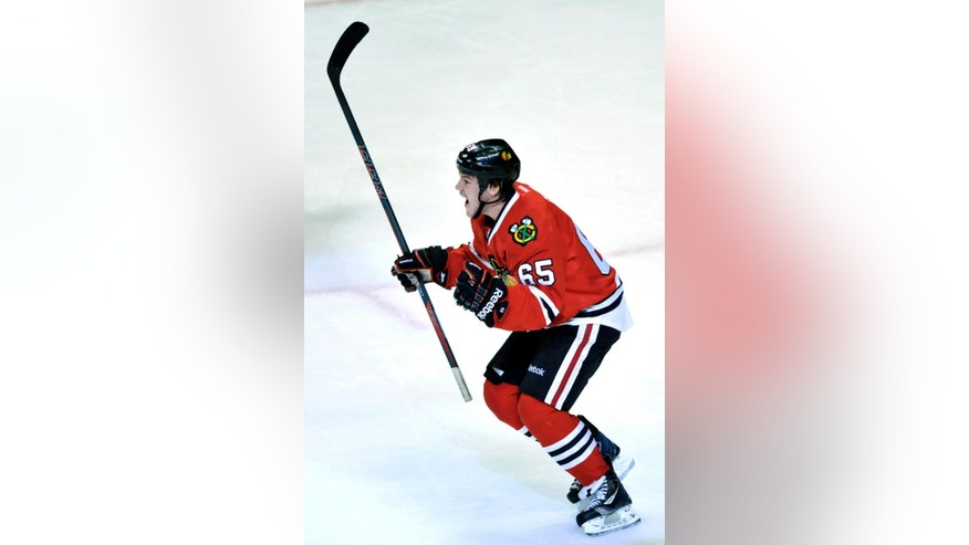 Chicago Blackhawks' Andrew Shaw (65), celebrates after scoring during the second period of an NHL hockey game against the St. Louis Blues in Chicago, Wednesday, March, 19, 2014. (AP Photo/Paul Beaty)