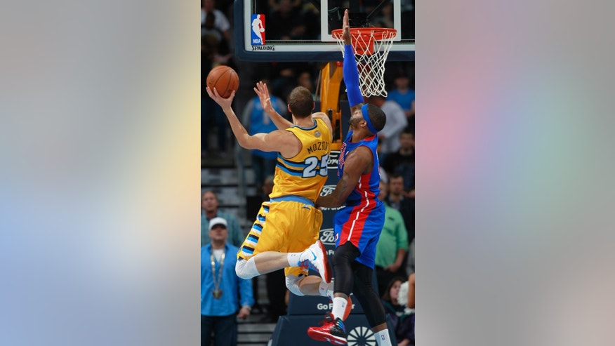 Denver Nuggets center Timofey Mozgov, left, of Russia, goes up for shot as Detroit Pistons forward Josh Smith covers in the first quarter of an NBA basketball game in Denver on Wednesday, March 19, 2014. (AP Photo/David Zalubowski)