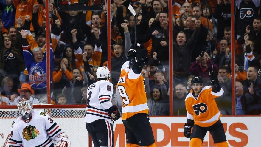 Philadelphia Flyers' Scott Hartnell (19) and Matt Read (24) celebrate after Hartnell's goal against Chicago Blackhawks' Antti Raanta (31), of Finland, and Nick Leddy (8) during the first period of an NHL hockey game, Tuesday, March 18, 2014, in Philadelphia. (AP Photo/Matt Slocum)