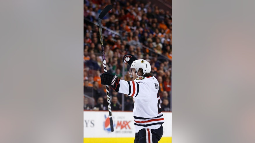 Chicago Blackhawks' Duncan Keith celebrates after scoring a goal during the first period of an NHL hockey game against the Philadelphia Flyers, Tuesday, March 18, 2014, in Philadelphia. (AP Photo/Matt Slocum)