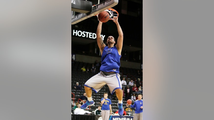 Delaware's Carl Baptiste dunks during practice for the NCAA college basketball tournament in Spokane, Wash., Wednesday, March 19, 2014. Delaware plays against Michigan State in a second round game on Thursday. (AP Photo/Young Kwak)