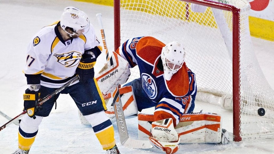 Nashville Predators' Patrick Eaves (17) is stopped by Edmonton Oilers goalie Viktor Fasth (35) during the second period of an NHL hockey game Tuesday, March 18, 2014, in Edmonton, Alberta. (AP Photo/The Canadian Press, Jason Franson)