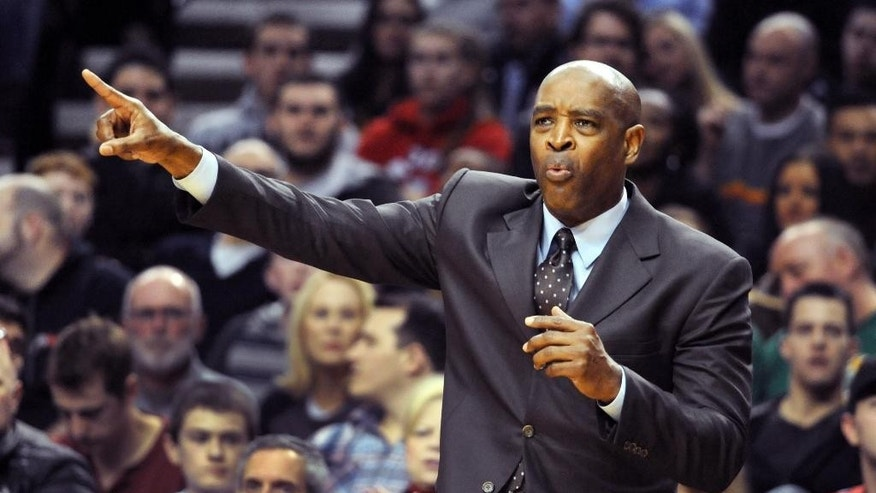 Milwaukee Bucks head coach Larry Drew directs his team during the first half of an NBA basketball game against the Portland Trail Blazers in Portland, Ore., Tuesday, March 18, 2014. (AP Photo/Steve Dykes)