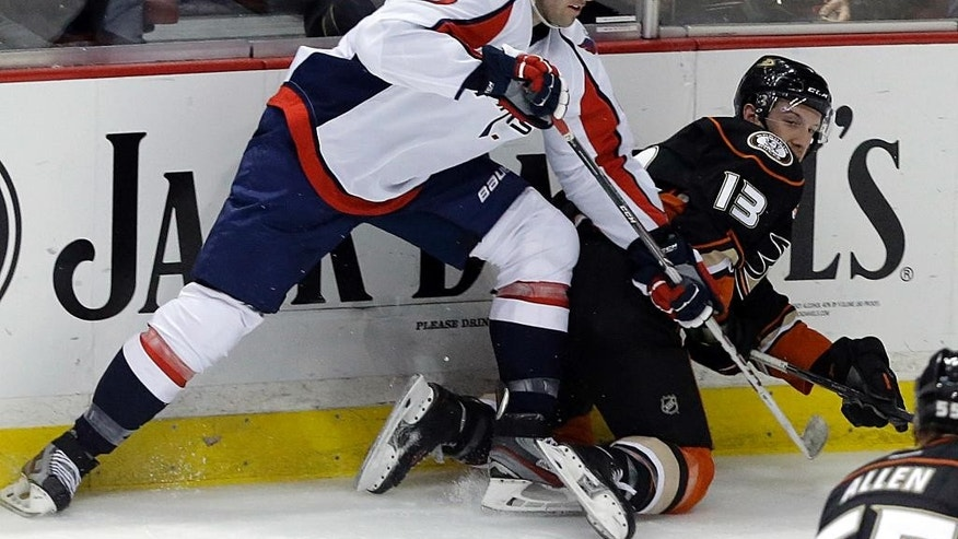 Washington Capitals right winger Dustin Penner (17) tangles with Anaheim Ducks center Nick Bonino (13) during the second period of an NHL hockey game Tuesday, March 18, 2014, in Anaheim, Calif. (AP Photo/Reed Saxon)