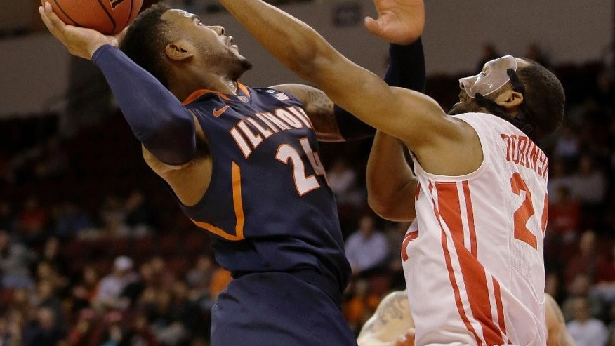 Illinois guard Rayvonte Rice (24) takes the ball to the hoop against Boston University forward Travis Robinson (24)during the second half of their NCAA mens NIT college basketball game in Boston, Wednesday, March 19, 2014. Illinois defeated Boston University 66-62 in a come-from-behind victory late in the second half advancing to the second round of the NIT Tournament. (AP Photo/Stephan Savoia)
