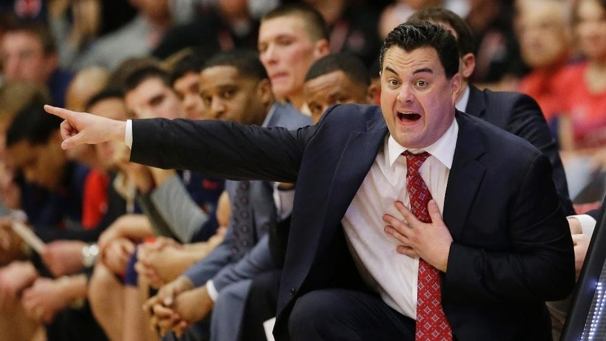 FILE - In this Jan. 29, 2014, file photo, Arizona coach Sean Miller gestures to his players during an NCAA college basketball game against Stanford  in Stanford, Calif. John Miller's sons _ Sean, who coaches No. 1 West seed Arizona; and younger brother Archie, who coaches No. 11 South seed Dayton _ could meet in the Final Four. (AP Photo/Marcio Jose Sanchez, File)