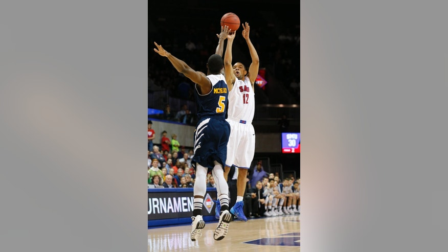 UC Irvine guard Chris McNealy (5) defends as SMU guard Nick Russell (12) shoots during the second half of an NCAA college basketball game in the first round of the NIT, Wednesday, March 19, 2014, in Dallas. SMU won 68-54. (AP Photo/Sharon Ellman)