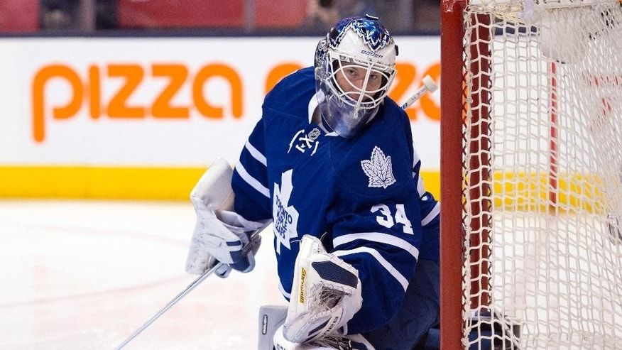 Toronto Maple Leafs goalie James Reimer reacts after being scored on during first period NHL action against the Tampa Bay Lightning in Toronto on Wednesday March 19, 2014. (AP Photo/The Canadian Press, Frank Gunn)