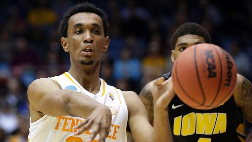 Tennessee guard Derek Reese (23) passes against Iowa in the first half of a first-round game of the NCAA college basketball tournament on Wednesday, March 19, 2014, in Dayton, Ohio. (AP Photo/Al Behrman)