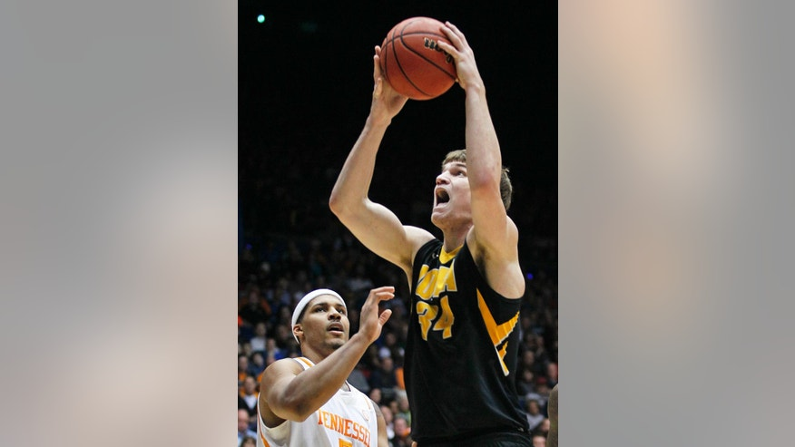 Iowa center Adam Woodbury (34) shoots against Tennessee forward Jarnell Stokes in the first half of a first-round game of the NCAA college basketball tournament on Wednesday, March 19, 2014, in Dayton, Ohio. (AP Photo/Skip Peterson)